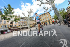 Age Group athlete during the run leg of the 2014 Ironman 70.3 Pays d'Aix, Aix en Provence on May 18, 2013.