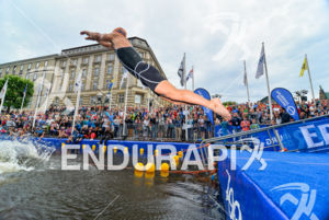 Japanese athlete jumps during Team Relay race at the 2014 Hamburg World Triathlon in Hamburg, Germany on July 12-13, 2014.