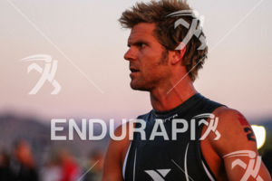 Justin Darerr gets into the zone prior to the start of the Ironman Boulder triathlon on August 3, 2014 in Boulder, Colorado