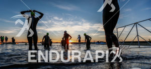 The sun rises as pro athletes warm up prior to the start of the  Ironman Boulder on August 3, 2014 in Boulder, Colorado