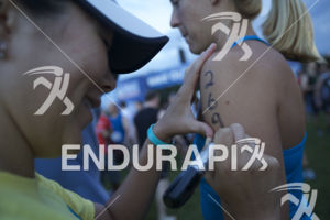 An age grouper undergoes body markings at the 2014 Nation's Triathlon in Washington, D.C. on September 7, 2014.