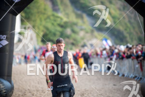 Matt Trautman leaves the swim in 3rd place at the 2014 Ironman Wales in Tenby, Pembrokeshire, Wales, United Kingdom on September 14, 2014