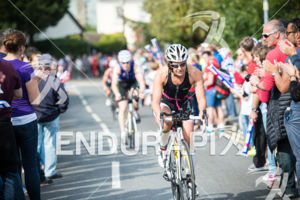 Age Grouper Andrea Mason leads on the on the bike at the 2014 Ironman Wales in Tenby, Pembrokeshire, Wales, United Kingdom on September 14, 2014.