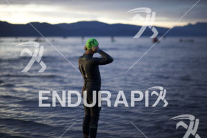 An athlete prepares for the swim start just prior to the race cancellation at the 2014 Ironman Lake Tahoe triathlon on September 21, 2014 in Lake Tahoe, CA.