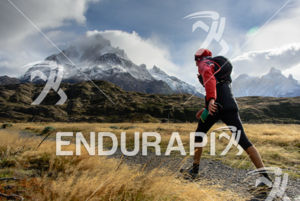 Athlete faces the mountain at the 2014 Ultra Trail Torres del Paine in Puerto Natales, Patagonia, Chile,  on September 26, 2014.