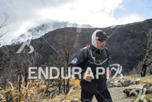 Athlete running with the iced mounain on the background at the 2014 Ultra Trail Torres del Paine in Puerto Natales, Patagonia, Chile,  on September 26, 2014.