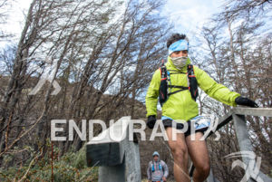 Athlete running into stairs at the 2014 Ultra Trail Torres del Paine in Puerto Natales, Patagonia, Chile,  on September 26, 2014.