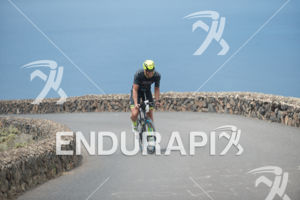 Athlete on the bike of the 2015 Ironman Lanzarote in Puerto del Carmen, Lanzarote, Spain,  on May 23, 2015.