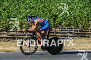 Andrew Fast bikes past the many vineyards at the 2015 Vineman Triathlon on July 25 in Sonoma County, California