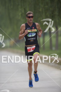 Greg Bennett (USA) holding first place on the run course at the 2015 Beijing International Triathlon on September 20, 2015 in Beijing, China.