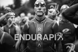 Age groupers line up for the swim start at the 2016 Ironman Vineman Triathlon in Sonoma County, CA on July 30, 2016.
