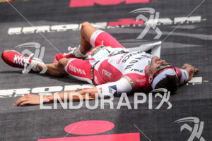 Jan Frodeno collapses after wining the 2016 GoPro Ironman World Championship in Kailua-Kona, HI on October 08, 2016.