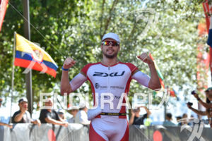 Franz Loeschke during the finish portion of the 2016 Ironman 70.3 Miami in Miami FL, USA on October 23, 2016.