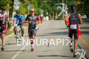 Pro Tj Tollakson running opposite fellow pro Blake Becker at the 2017 Ironman Wisconsin on September 10, 2017 in Madison, WI.
