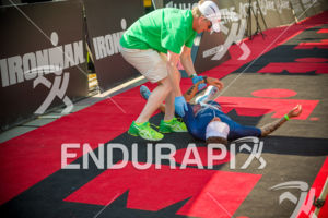 Pro Patrick Mckeon collapses just past the finish after a blistering2:43 marathon to run up to 3rd place at the 2017 Ironman Wisconsin on September 10, 2017 in Madison, WI.