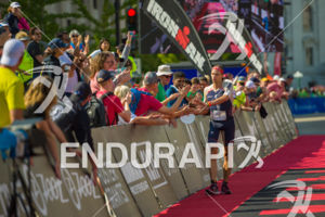 Pro Andrew Starykowicz appreciates the rousing reception on his finish at the 2017 Ironman Wisconsin on September 10, 2017 in Madison, WI.