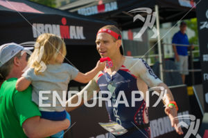 Pro Andrew Starykowicz is greeted by his daughter after his 4th place finish and comeback to Ironman at the 2017 Ironman Wisconsin on September 10, 2017 in Madison, WI.
