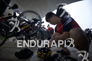 An age grouper preps his transition area at the 2017 Beijing International Triathlon on September 10, 2017 in Beijing, China.