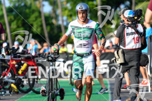 Lionel Sanders (CAN) competes in the transition zone during the bike leg at the 2017 Ironman World Championship in Kailua-Kona, Hawaii on October 14, 2017.