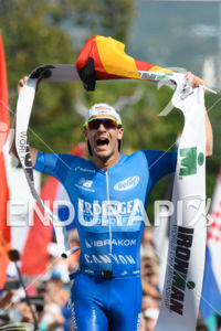 Patrick Lange (GER) celebrates at the finish of the 2017 Ironman World Championship in Kailua-Kona, Hawaii on October 14, 2017.