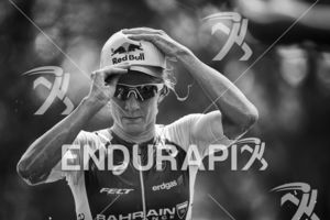 Daniela Ryf places ice water in her cap as she passes an aid station at roughly mile 10.6 of the run course at the 2017 Ironman World Championship in Kailua Kona, HI on October 14, 2017.