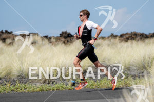 David Mcnamee (GBR) competes during the run leg thru the Natural Energy Lab at the 2017 Ironman World Championship in Kailua-Kona, Hawaii on October 14, 2017.