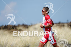 Terenzo Bozzone (NZL) competes during the run leg thru the Natural Energy Lab at the 2017 Ironman World Championship in Kailua-Kona, Hawaii on October 14, 2017.