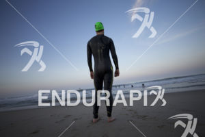 Pros begin to warm up for the swim at the 2018 Escape Surf City Triathlon on April 22, 2018 in Huntington Beach, CA.