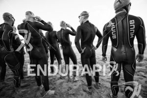 The pro men line up for the swim start at the 2018 Escape Surf City Triathlon on April 22, 2018 in Huntington Beach, CA.
