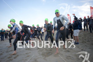 The pro men start the swim leg at the 2018 Escape Surf City Triathlon on April 22, 2018 in Huntington Beach, CA.
