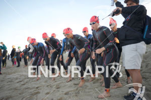 The pro women line up for the swim start at the 2018 Escape Surf City Triathlon on April 22, 2018 in Huntington Beach, CA.
