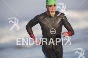 Cameron Dye exits the swim leg at the 2018 Escape Surf City Triathlon on April 22, 2018 in Huntington Beach, CA.