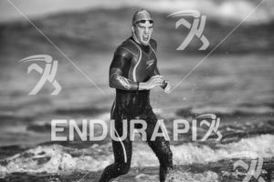 Ryan Fisher exits the swim leg at the 2018 Escape Surf City Triathlon on April 22, 2018 in Huntington Beach, CA.