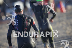 Pro men make their way to transition at the 2018 Escape Surf City Triathlon on April 22, 2018 in Huntington Beach, CA.