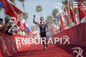 Jason West claims victory at the 2018 Escape Surf City Triathlon on April 22, 2018 in Huntington Beach, CA.