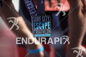 A pro recovers at the finish of the 2018 Escape Surf City Triathlon on April 22, 2018 in Huntington Beach, CA.