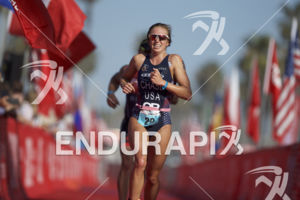 Sophie Chase is victorious at the 2018 Escape Surf City Triathlon on April 22, 2018 in Huntington Beach, CA.