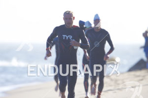 Ben Kanute makes his way from the swim exit to the transition area at Escape From Alcatraz Triathlon on June 3, 2018 in San Francisco, CA.