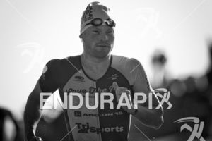 Eric Lagerstom makes his way from the swim exit to the transition area at Escape From Alcatraz Triathlon on June 3, 2018 in San Francisco, CA.