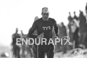 Andy Potts makes his way from the swim exit to the transition area at Escape From Alcatraz Triathlon on June 3, 2018 in San Francisco, CA.
