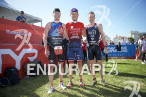 Cameron Dye, Ben Kanute and Jason West (left to right) at the finish of the Escape From Alcatraz Triathlon on June 3, 2018 in San Francisco, CA.
