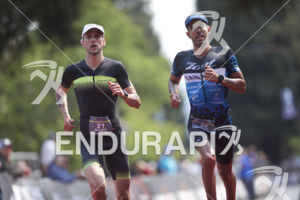 Matthew Shanks and Breno Melo (L to R) at the finish of the 2018 Ironman 70.3 Santa Rosa in Sonoma County, CA on July 28, 2018.