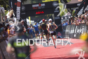 Age groupers reach the finishline of the 2018 Ironman 70.3 Santa Rosa in Sonoma County, CA on July 28, 2018.