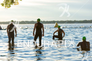 Swimmers gather and relax prior to their start in the high water at the 2018 Ironman Wisconsin on September 09, 2018 in Madison, WI.