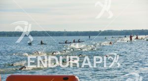 Swimmers negotiate the final stretch of the swim course under watchful eye of safety personnel at the 2018 Ironman Wisconsin on September 09, 2018 in Madison, WI.