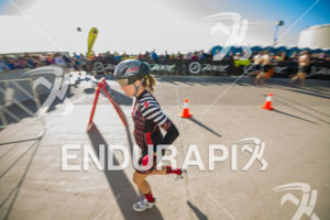 Female athlete exiting change room on the way to her bike in front of a great crowd  at the 2018 Ironman Wisconsin on September 09, 2018 in Madison, WI.