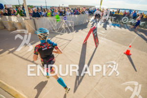Female athlete in front of a great crowd cheering at T1 at the 2018 Ironman Wisconsin on September 09, 2018 in Madison, WI.