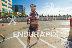 Male athlete in front of a great crowd cheering at T1 at the 2018 Ironman Wisconsin on September 09, 2018 in Madison, WI.