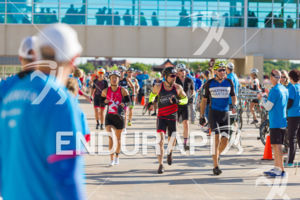 Age group athletes running through T1 in front of the large crowds at the 2018 Ironman Wisconsin on September 09, 2018 in Madison, WI.
