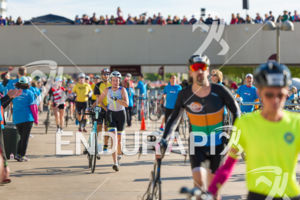 Crowds cheering as athletes work their way through transition to their bikes at the 2018 Ironman Wisconsin on September 09, 2018 in Madison, WI.